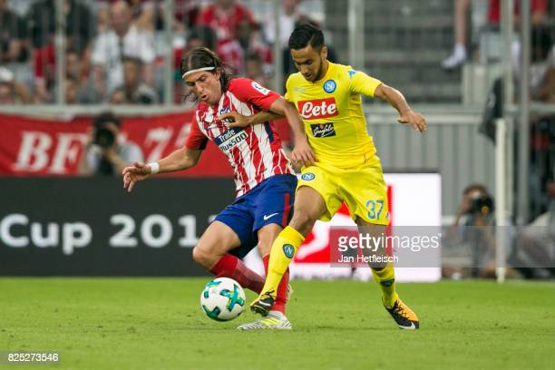 Filipe Luis of Atletico Madrid and Adam Ounas of SSC Napoli fight for the ball during the Audi Cup 2017 match between Club Atletico de Madrid and SSC...