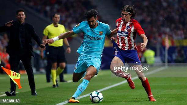 Filipe Luis of Atletico Madrid and Andre Gomes battle for the ball during the La Liga match between Club Atletico Madrid and FC Barcelona at Estadio...