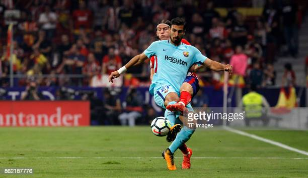 Filipe Luis of Atletico Madrid and Andre Gomes of Barcelona battle for the ball during the La Liga match between Club Atletico Madrid and FC...
