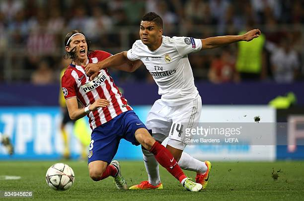 Felipe Luis of Atletico Madrid and Casemiro of Real Madrid compete for the ball during the UEFA Champions League Final between Real Madrid and Club...