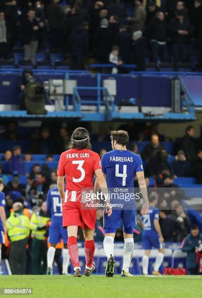 Filipe Luis of Atletico Madrid and Cesc Fabregas of Chelsea FC leave the pitch after half time of the UEFA Champions League Group C soccer match...