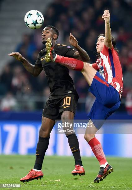 Filipe Luis of Atletico Madrid challenges Gerson of AS Roma during the UEFA Champions League group C match between Atletico Madrid and AS Roma at...
