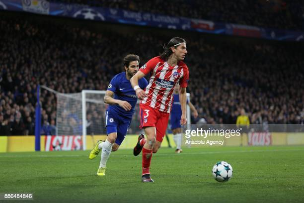 Filipe Luis of Atletico Madrid in action against Cesc Fabregas of Chelsea FC during the UEFA Champions League Group C soccer match between Chelsea FC...
