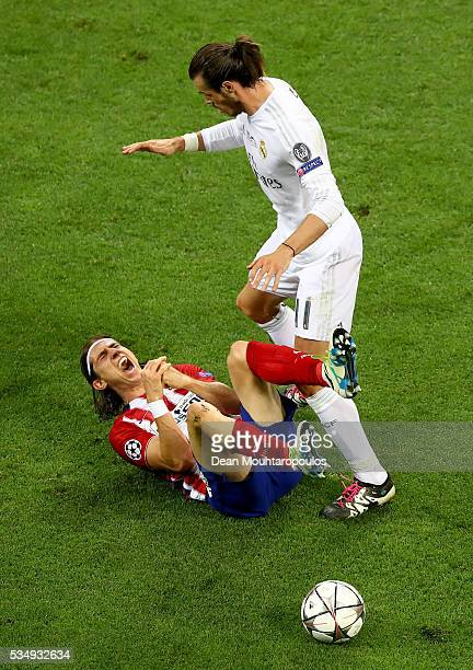 Filipe Luis of Atletico Madrid is fould by Gareth Bale of Real Madrid during the UEFA Champions League Final match between Real Madrid and Club...
