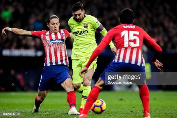 Filipe Luis of Atletico Madrid Lionel Messi of FC Barcelona Savic of Atletico Madrid during the La Liga Santander match between Atletico Madrid v FC...
