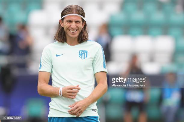 Filipe Luis of Atletico Madrid smiles during a training session ahead of the UEFA Super Cup match against Real Madrid CF at Lillekuela Stadium on...