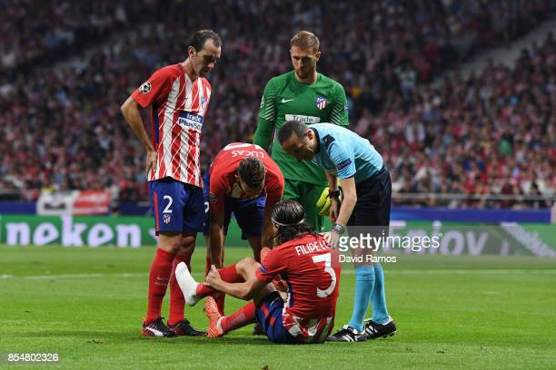 Filipe Luis of Atletico Madrid speaks with the referee following RSC Anderlecht injury during the UEFA Champions League group C match between...
