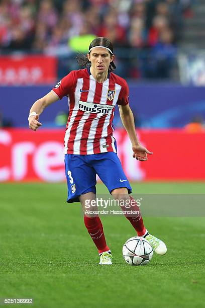 Filipe Luis of Atltetico runs with the ball during the UEFA Champions League semi final first leg match between Club Atletico de Madrid and FC Bayern...