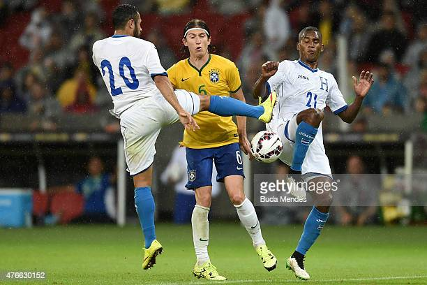 Filipe Luis of Brazil and Alfredo Mejía and Beckeles of Honduras compete for the ball during the International Friendly Match between Brazil and...