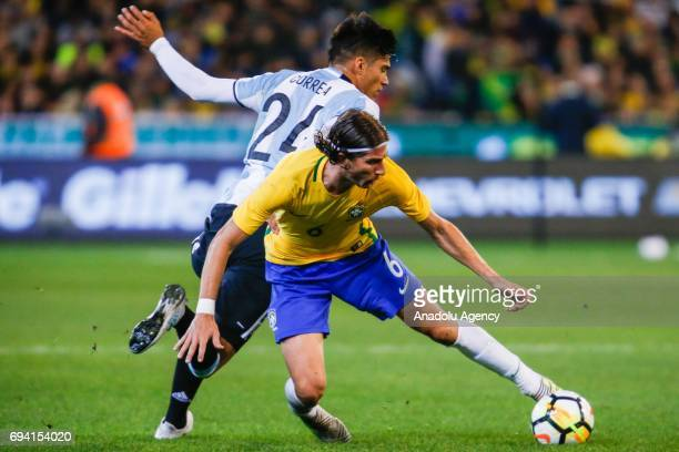 Filipe Luis of Brazil controls the ball away from Joaquin Correa of Argentina during a friendly football match between Argentina and Brazil at the...