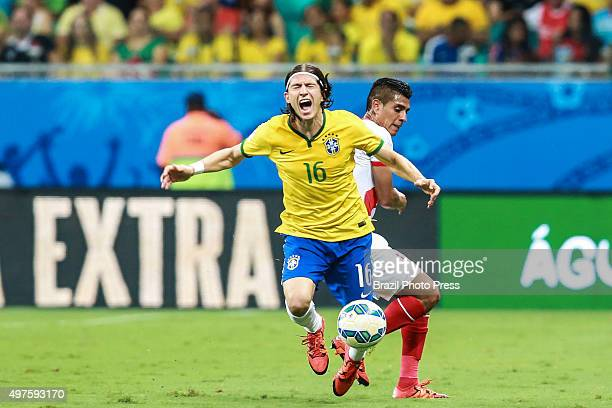Filipe Luis of Brazil falls down after being fouled during a match between Brazil and Peru as part of FIFA 2018 World Cup Qualifiers at Arena Fonte...
