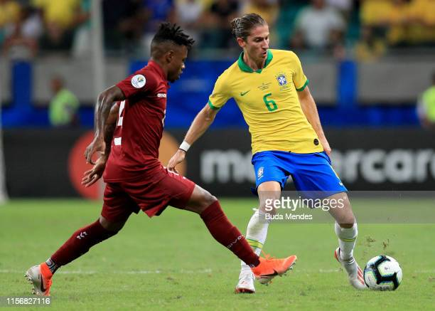 Filipe Luis of Brazil fights for the ball with Jhon Murillo of Venezuela during the Copa America Brazil 2019 group A match between Brazil and...