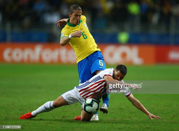 Filipe Luis of Brazil fights for the ball with Richard Sanchez of Paraguay during the Copa America Brazil 2019 quarterfinal match between Brazil and...