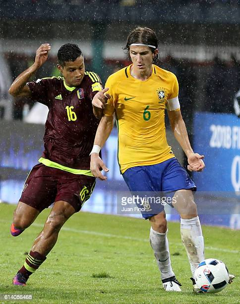 Filipe Luis of Brazil fights for the ball with Roberto Rosales of Venezuela during a match between Venezuela and Brazil as part of FIFA 2018 World...