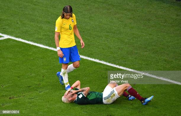 Filipe Luis of Brazil looks at Miguel Layun of Mexico liying injured during the 2018 FIFA World Cup Russia Round of 16 match between Brazil and...