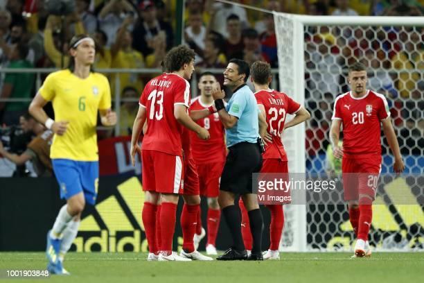 Filipe Luis of Brazil Milos Veljkovic of Serbia Aleksandar Mitrovic of Serbia referee Alireza Faghani Adem Ljajic of Serbia Sergej MilinkovicSavic of...