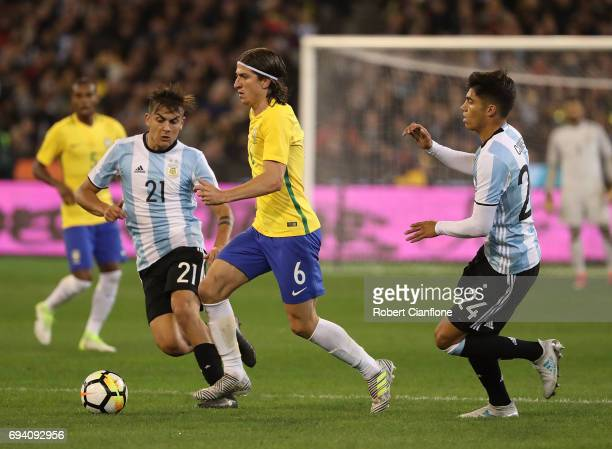 Filipe Luis of Brazil runs with the ball during the Brazil Global Tour match between Brazil and Argentina at Melbourne Cricket Ground on June 9 2017...