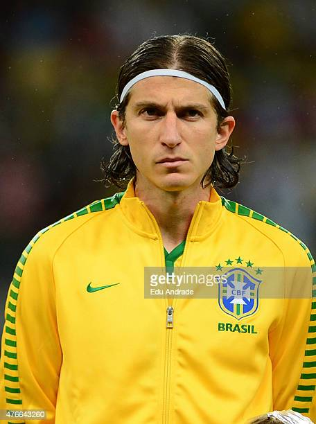 Filipe Luis of Brazil stands for the national anthem prior to the international friendly match between Brazil and Honduras at Beira Rio Stadium on...