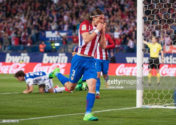Felipe Luis of Club Atletico de Madrid celebrates after scoring his team's 1st goal during the La Liga match between Club Atletico de Madrid and Real...