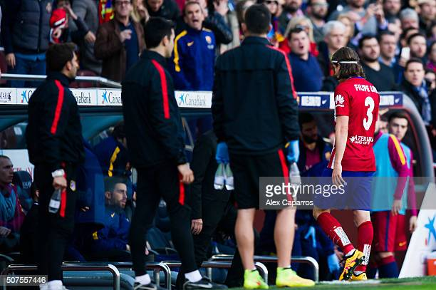Filipe Luis of Club Atletico de Madrid leaves the pitch after being shown a red card during the La Liga match between FC Barcelona and Club Atletico...