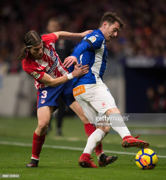 Felipe Luis of Club Atletico de Madrid loses the ball to Ibai Gomez of Deportivo Alaves during the La Liga match between Atletico Madrid and...