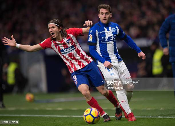 Felipe Luis of Club Atletico de Madrid protests after being tackled by Ibai Gomez of Deportivo Alaves during the La Liga match between Atletico...