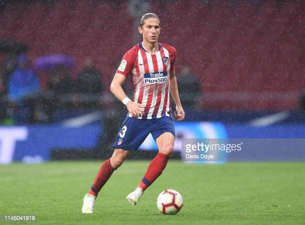 Filipe Luis of Club Atletico de Madrid runs with the ball during the La Liga match between Club Atletico de Madrid and Valencia CF at Wanda...