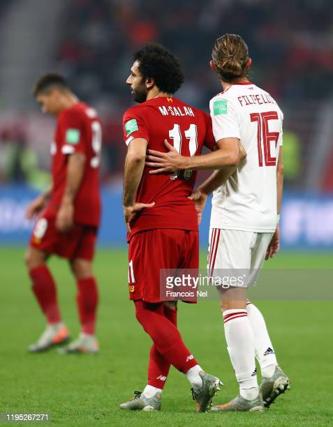 Filipe Luis of CR Flamengo comforts Mohamed Salah of Liverpool during the FIFA Club World Cup Qatar 2019 Final between Liverpool FC and CR Flamengo...