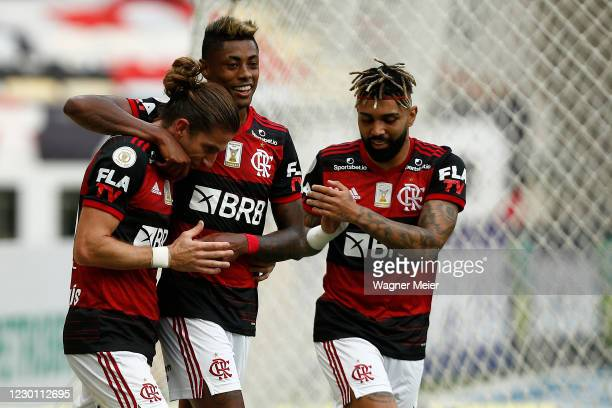 Filipe Luis of Flamengo celebrates his goal with teammates Bruno Henrique and Gabriel Barbosa during a match between Flamengo and Santos as part of...