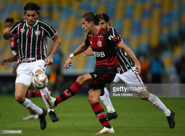 Filipe Luis of Flamengo kicks the ball during the match between Flamengo and Fluminense as part of the Taca Rio the Second Leg of the Carioca State...