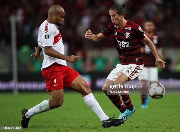 Filipe Luis of Flamengo struggles for the ball with a Rodrigo Moledo of Internacional during a match between Flamengo and Internacional as part of...