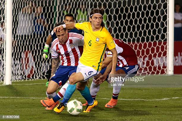 Filipe Luís of Brazil drives the ball as Juan Iturbe of Paraguay defends during a match between Paraguay and Brazil as part of FIFA 2018 World Cup...