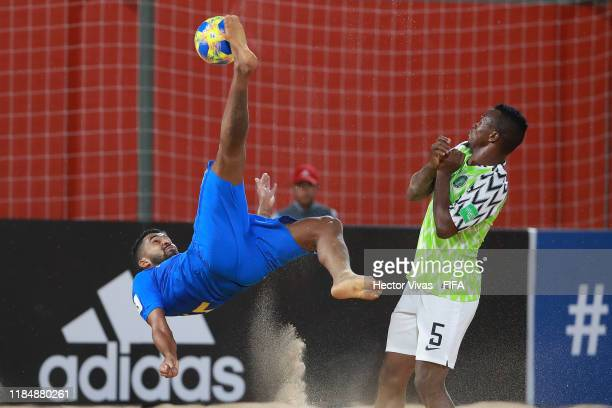 Filipe of Brazil struggles for the ball with Godspower Igudia of Nigeria during the FIFA Beach Soccer World Cup Paraguay 2019 group D match between...
