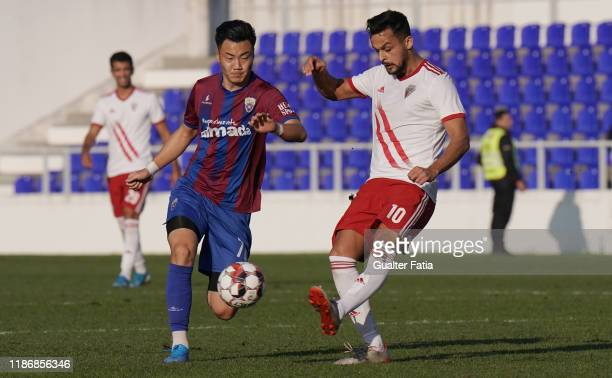 Filipe Oliveira of UD Vilafranquense with Liu Yuhao of CD Cova da Piedade in action during the Liga Pro match between CD Cova da Piedade and UD...