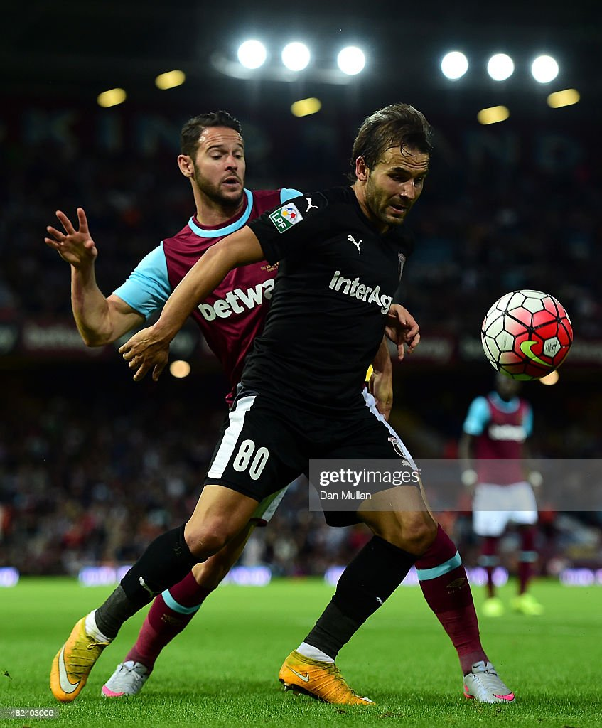 Filipe Teixeira of Astra Giurgiu holds off Matthew Jarvis of West Ham during the UEFA Europa League third qualifying round match between West Ham United and Astra Giurgiu at the Boleyn Ground on July 30, 2015 in London, England.