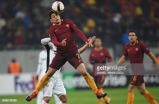 Filipe Teixeira of Astra Giurgiu vies for the ball with Juan Iturbe of AS Roma during the UEFA Europa League Group E football match between FC Astra...