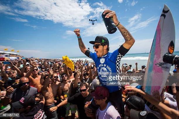 Filipe Toledo celebrates with friend family and fans after winning during the final round of the men's surfing main event during the last day of the...