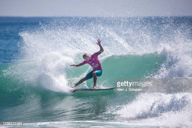 Filipe Toledo, of Brazil, does a turn on a big wave while competing against three-time WSL World Champion Gabriel Medina, of Brazil, who went to win...