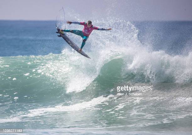 Filipe Toledo, of Brazil, does an aerial over a big wave while competing against fellow countryman and former WSL world champion Italo Ferreira, in...