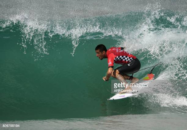 Filipe Toledo of Brazil gets a tube ride before winning his men's round five heat at the US Open of Surfing in Huntington Beach California on August...