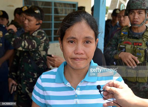 Filipina Marites Flor is seen after she was released by Abu Sayyaf Islamic militants in Jolo the southern island of Mindanao on June 24 2016 Flor a...