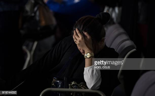 A Filipina overseas worker returning home from Kuwait is pictured upon arrival at Manila International Airport on February 18 2018 After a horrific...