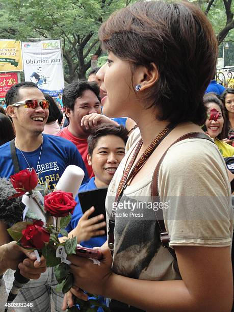 Filipina student Katrina Tapia gives an interview to the media as she recounts being given roses by naked runners from the Filipino fraternity Alpha...