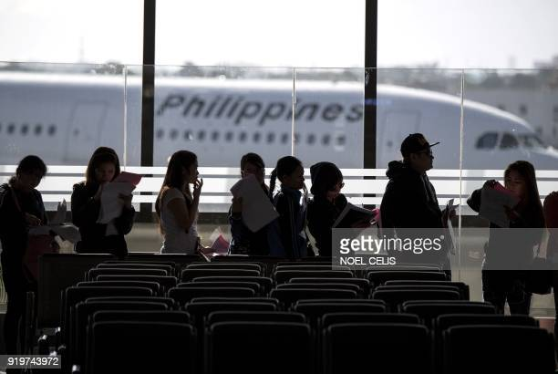 Filipina workers returning home from Kuwait arrive at Manila International Airport on February 18 2018 After a horrific murder of a Philippine maid...