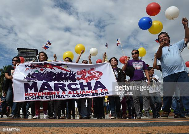 Filipino activists and Vietnamese nationals march as they anticipate a favourable decision from a UN tribunal ruling on the legality of China's...