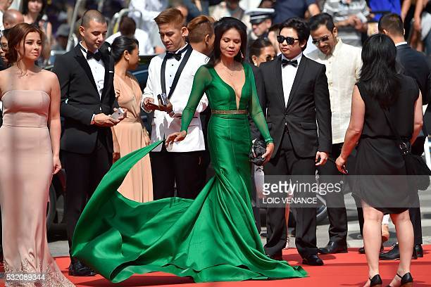 Filipino actress Maria Isabel Lopez poses as she arrives on May 18 2016 with Filipino actress Andi Eigenmann Filipino actor John Paul Duray and...