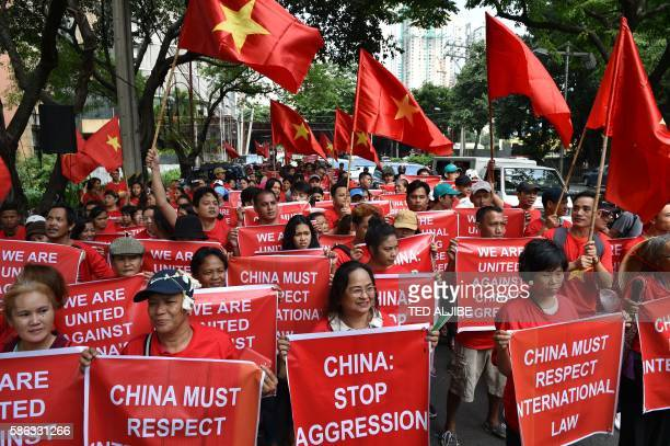 Filipino and Vietnamese protesters display antiChina placards and Vietnamese national flags during a call on China to respect their rights in the...
