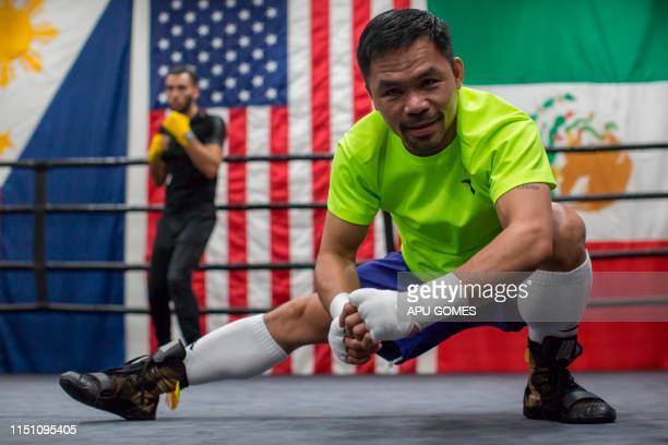 TOPSHOT Filipino boxer Manny Pacquiao attends an afternoon training session at Wild Card Boxing in Los Angeles on June 20 2019 Veteran trainer...