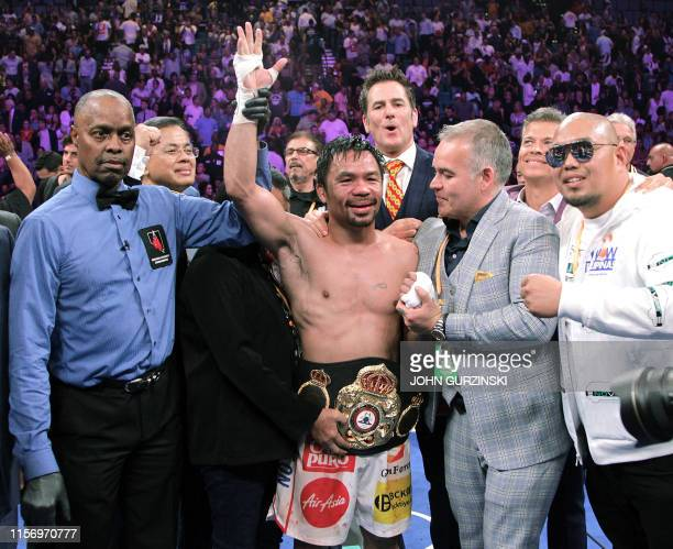 Filipino boxer Manny Pacquiao celebrates after beating US boxer Keith Thurman during their WBA super world welterweight title fight at the MGM Grand...