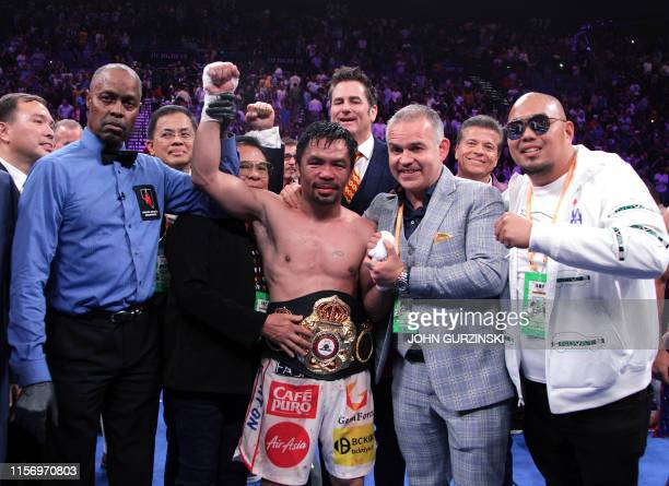 TOPSHOT Filipino boxer Manny Pacquiao celebrates after defeating US boxer Keith Thurman during their WBA super world welterweight title fight at the...